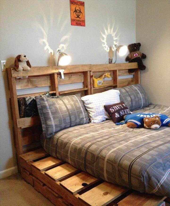 upcycled pallet bed with decorative headboard