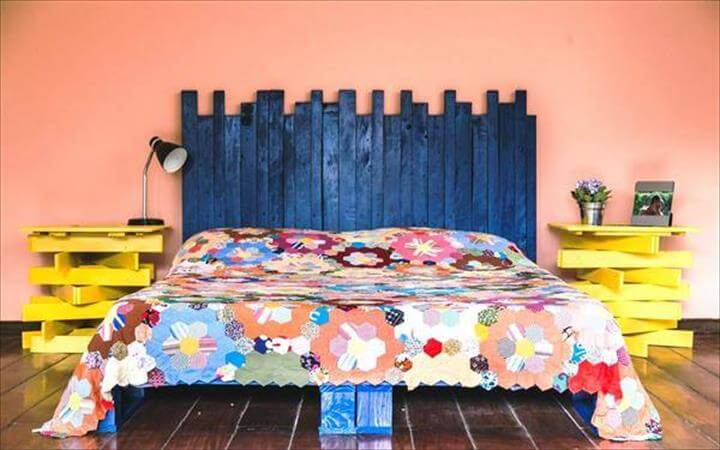 pallet platform bed with blue headboard