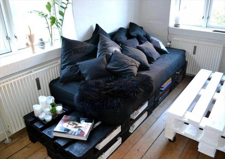 black stained pallet sofa with book storage