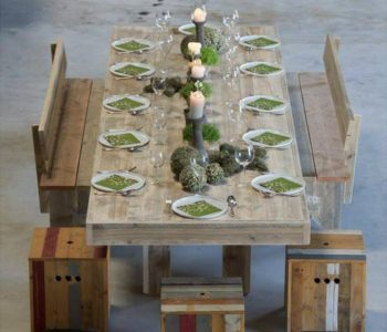 recycled pallet dining table with benches and stools