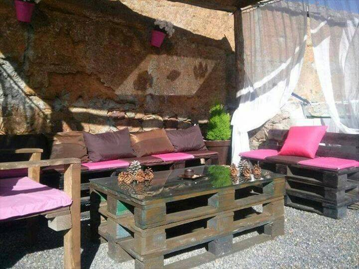 wooden pallet cushioned patio sofa with chairs and coffee table