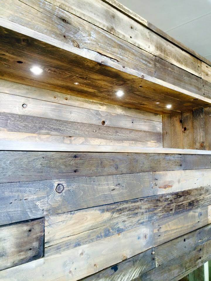 recycled pallet headboard with lights and storage