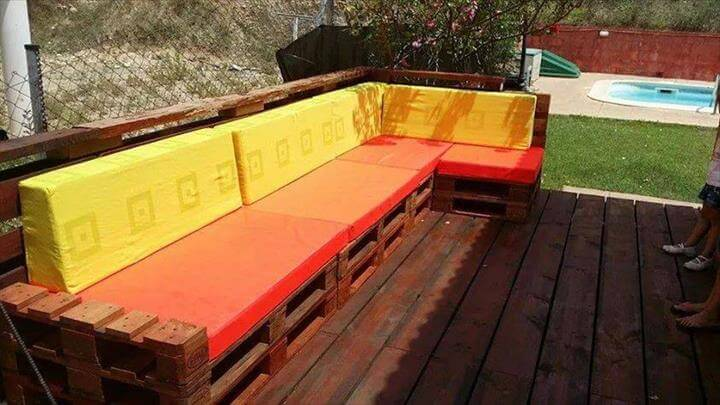 x-large pallet L-shaped patio sofa with orange cushion