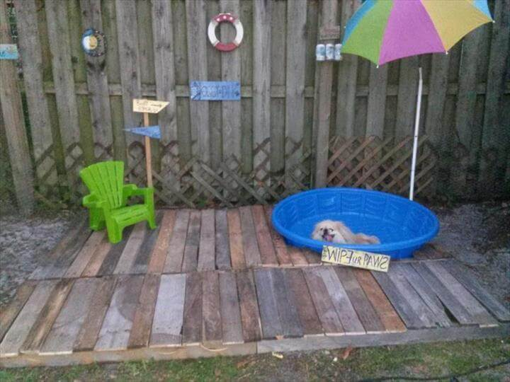 pallet garden doggie pool with blue bathtubs