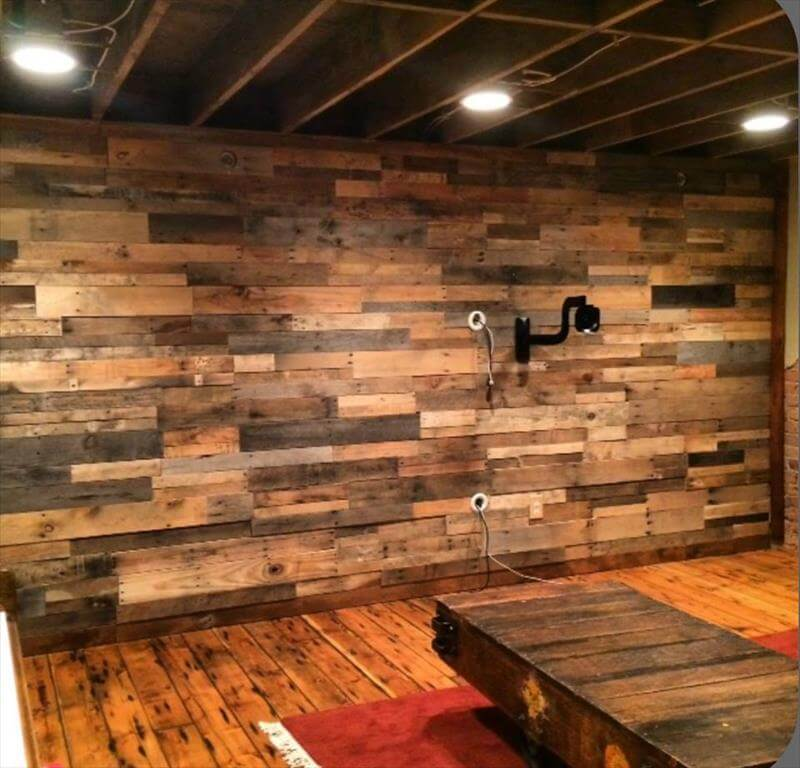 pallet wood paneled wall with scones lights