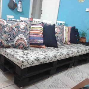 cushioned sofa made of pallets