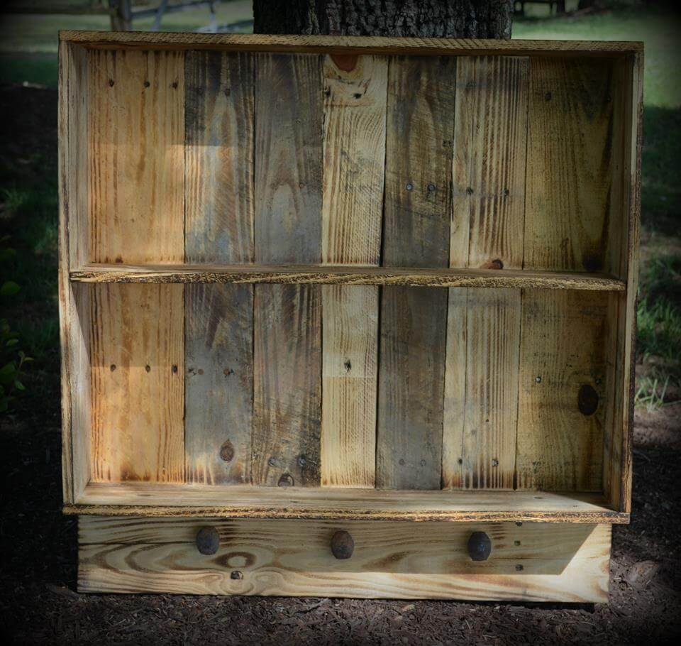 recycled pallet wall shelf with knobs