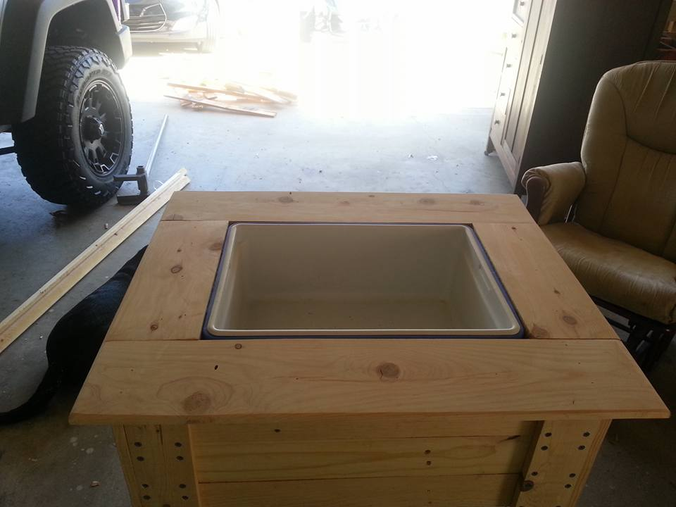 fitting of cooler inside the wooden holding