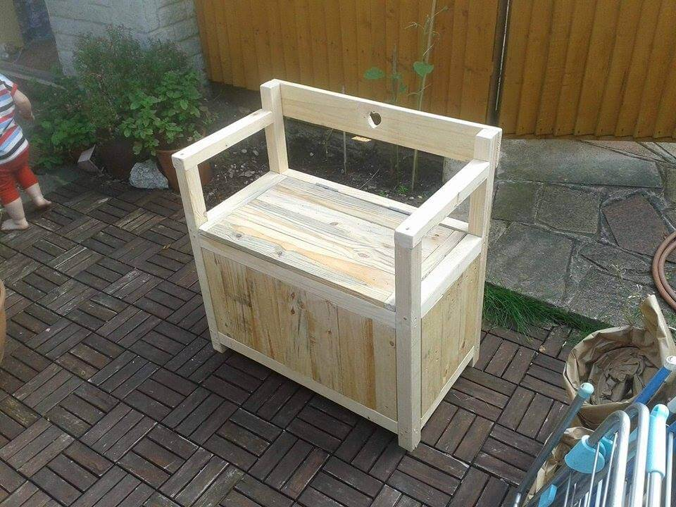 sturdy wooden pallet chair with inside storage space