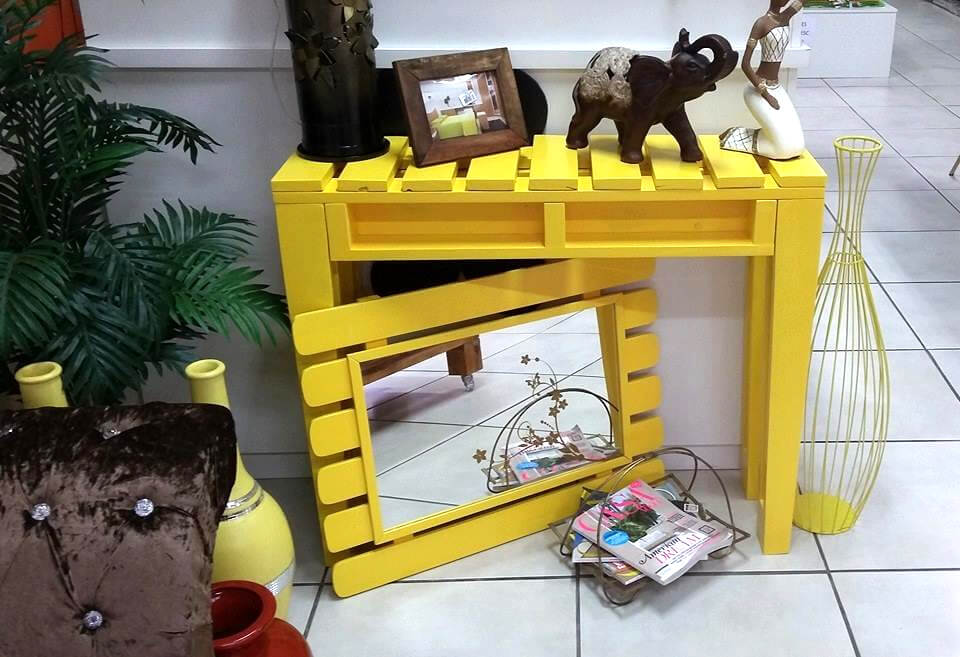 yellow painted pallet entryway console and mirror set