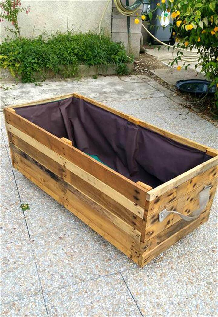 large wooden pallet planter with inside covered with waterproof felt