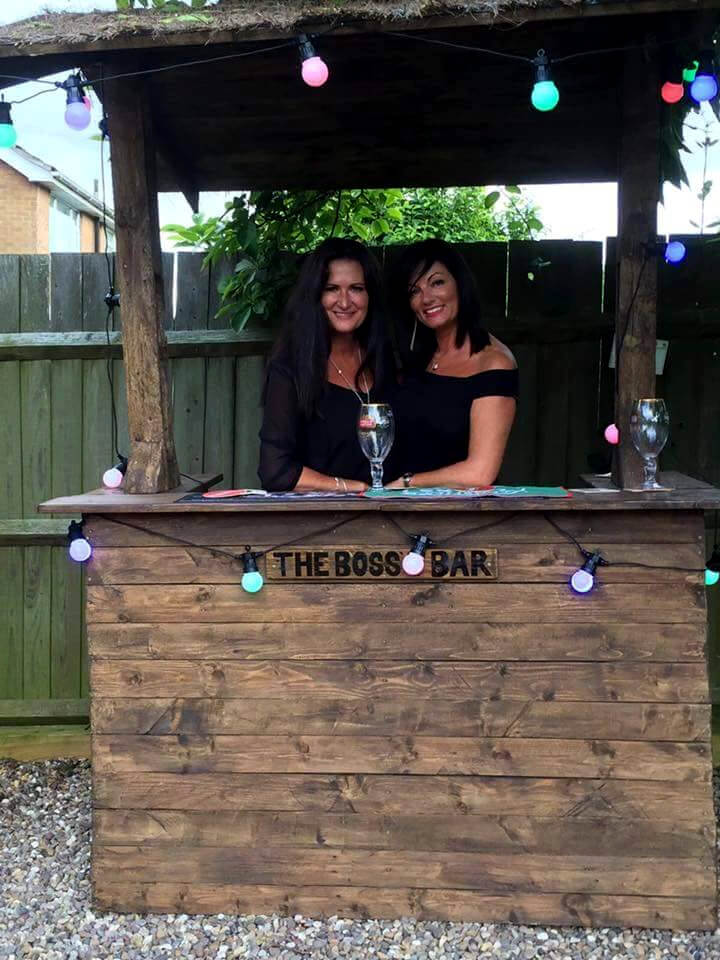 upcycled wooden pallet outdoor bar with light bulbs
