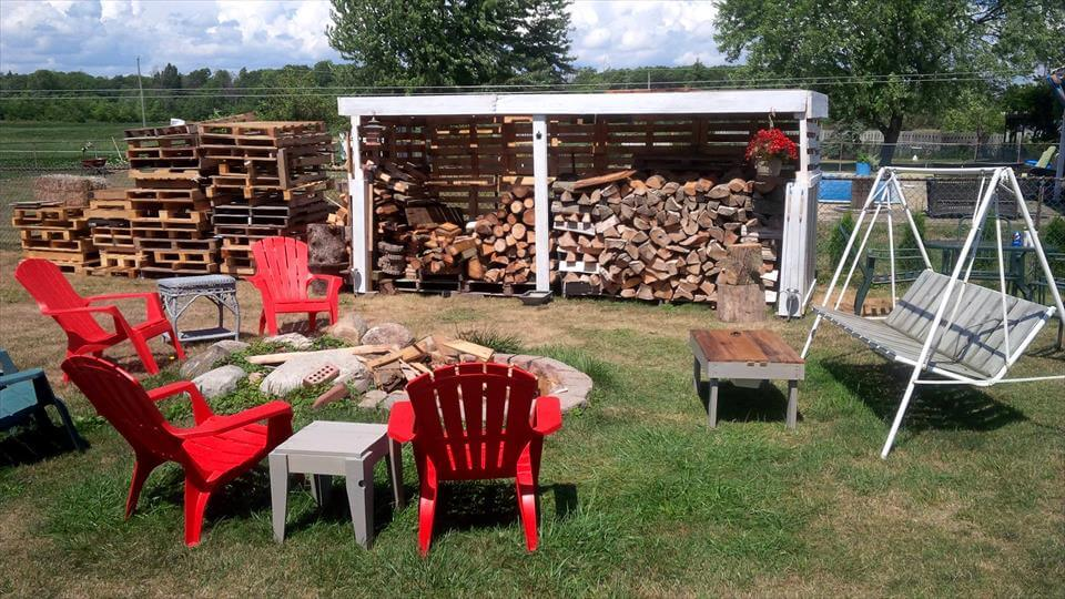 a little white painted pallet firewood shed