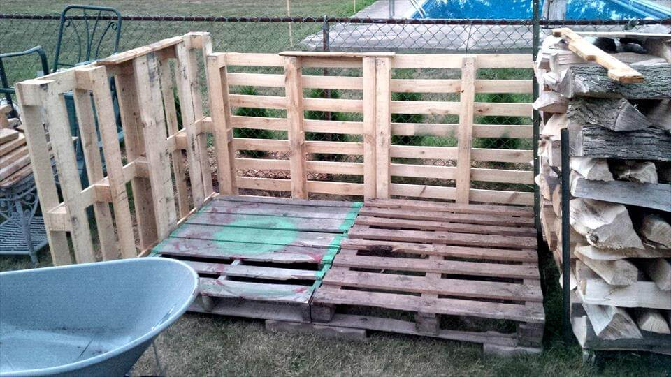 repurposed pallet firewood shed installation