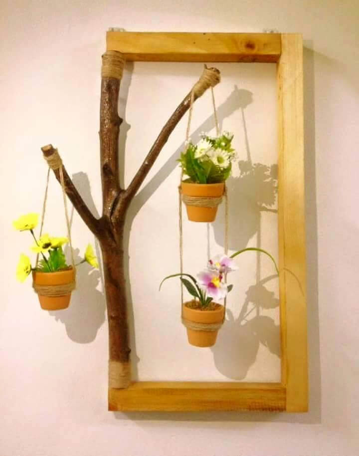 custom wooden pallet and old tree branches hanging pot wall art
