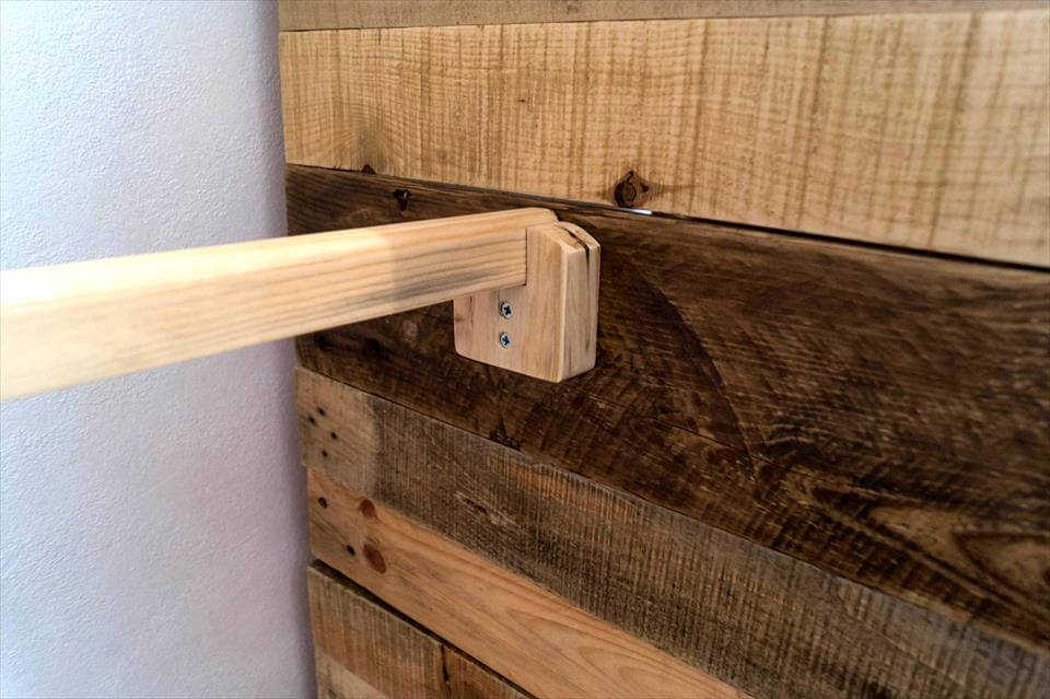 repurposed wooden pallet corner cupboard or closet