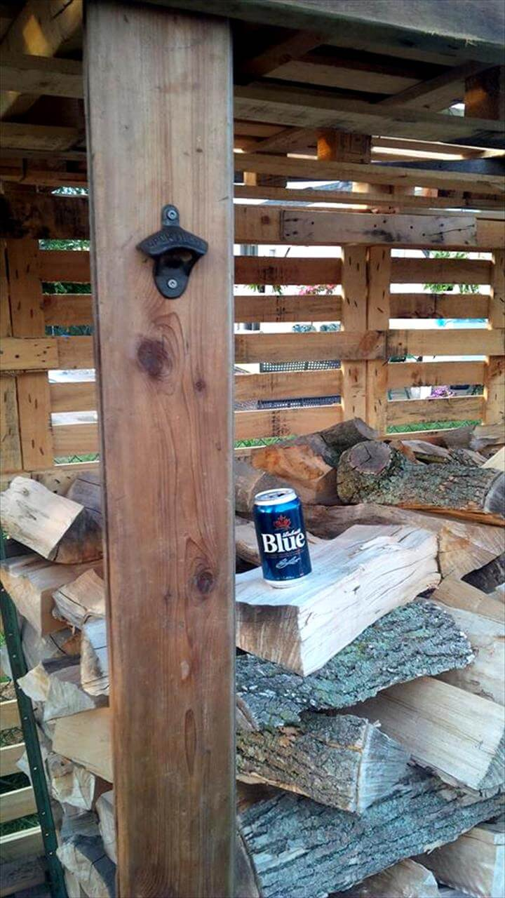 bottle opener fixed to firewood shed pillar