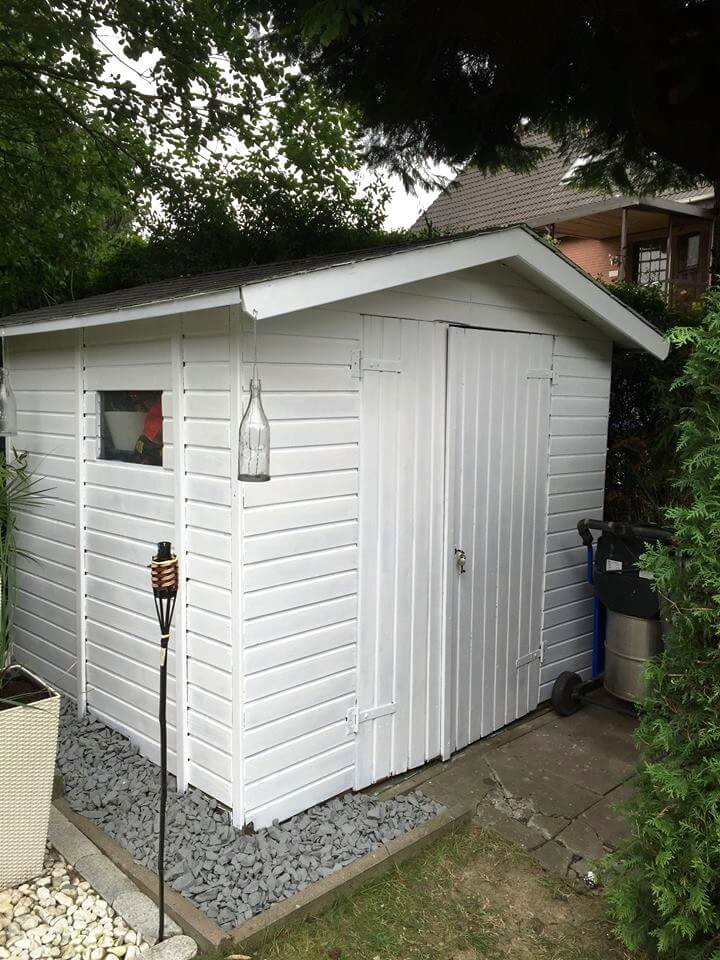 white painted pallet shed