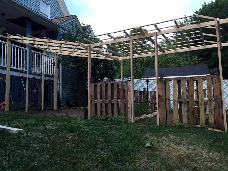 handmade wooden pallet garden with overhead trellis setup