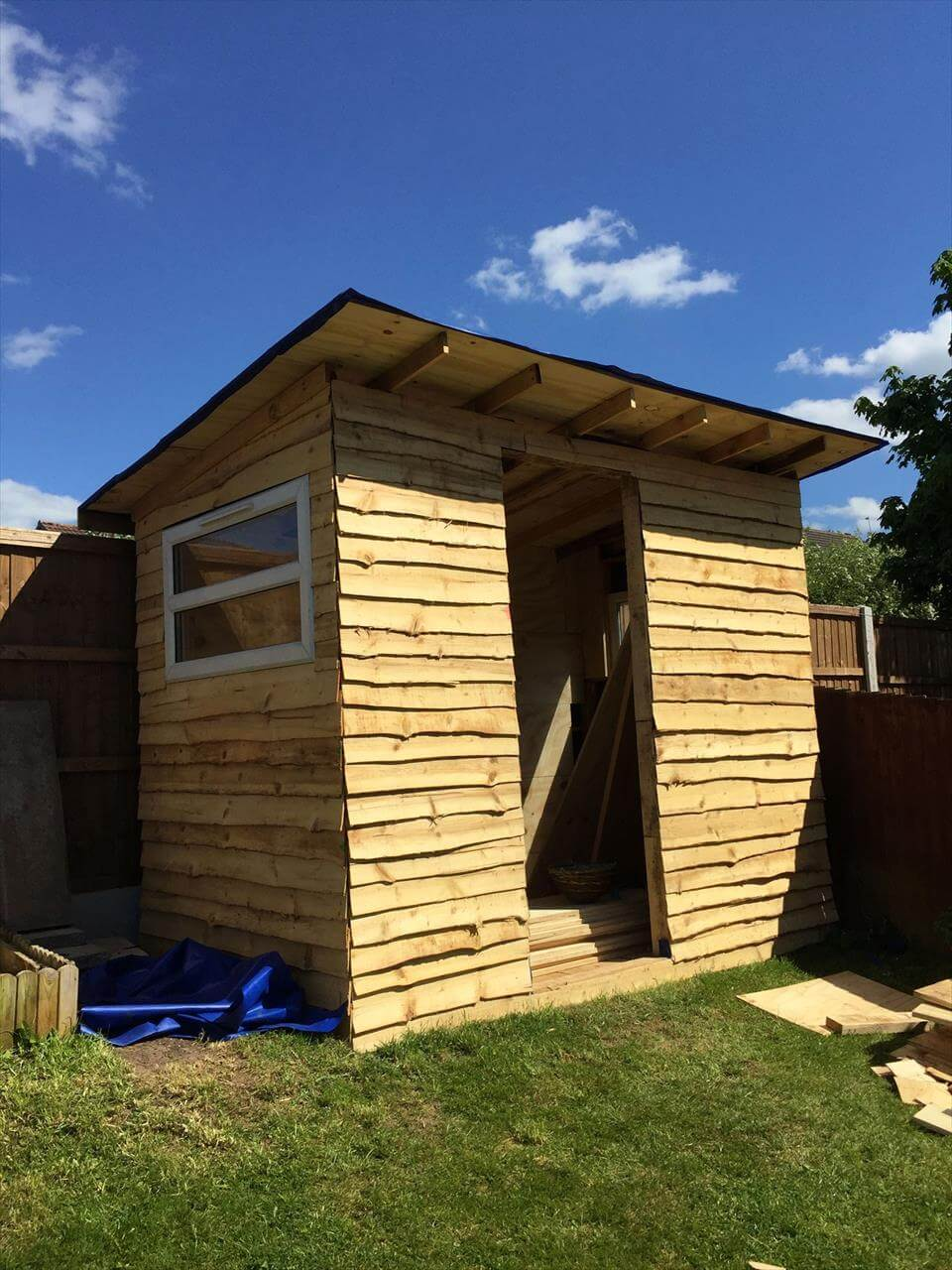low-cost wooden pallet shed