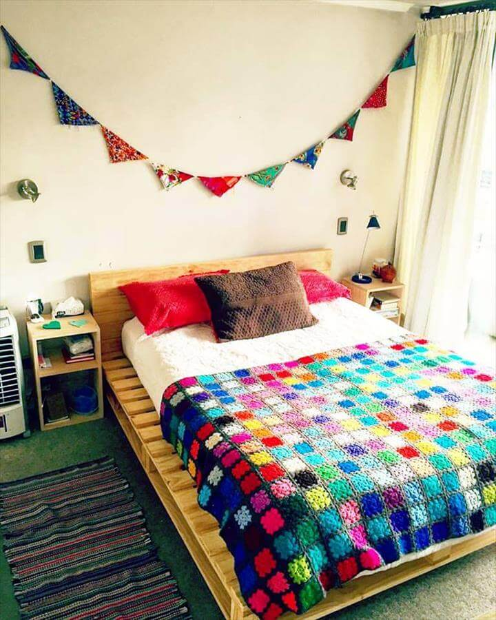 self-installed pallet bed with headboard