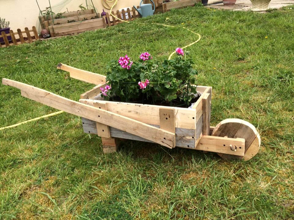wheelbarrow planter made of pallets