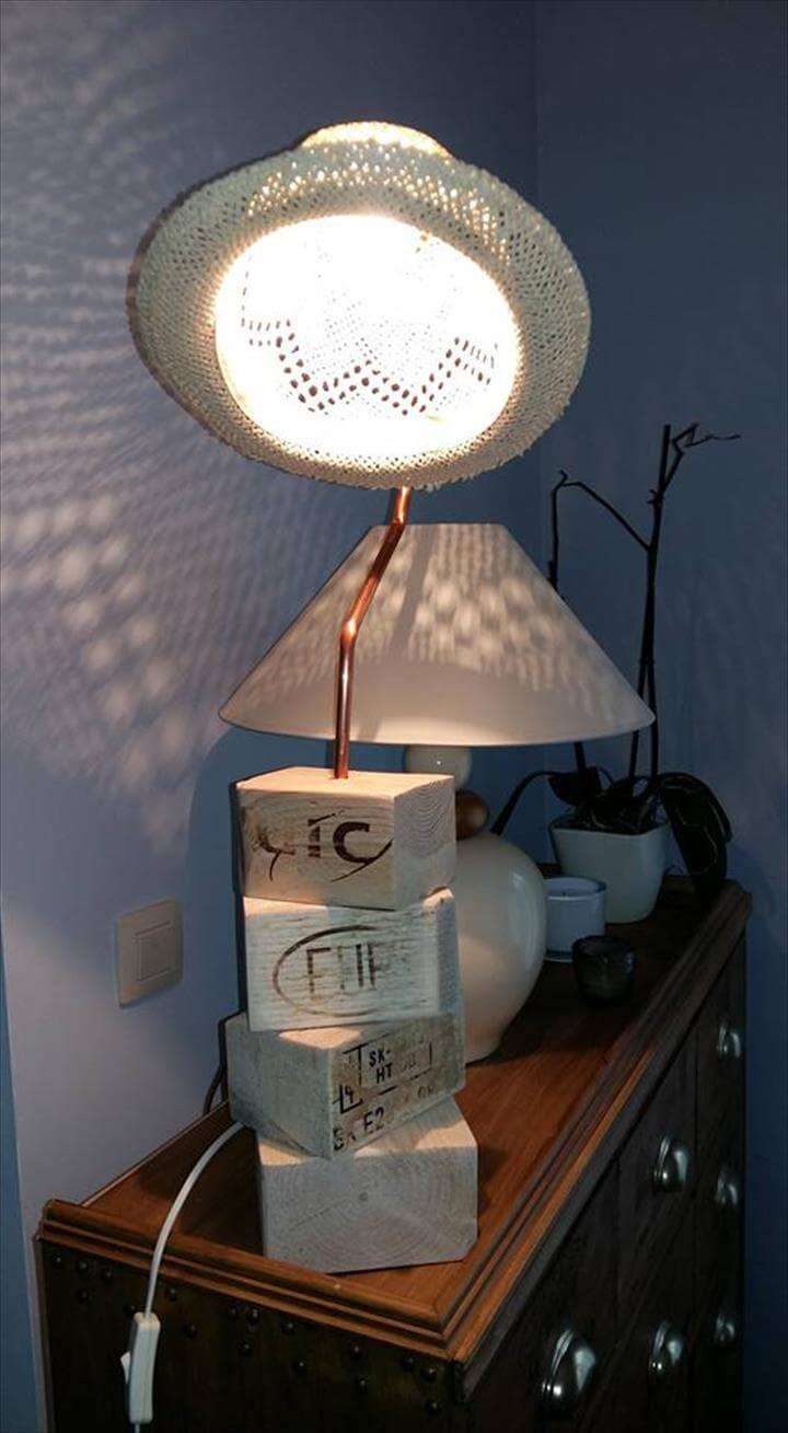 recycled old pallet wood remains and old hat table lamp
