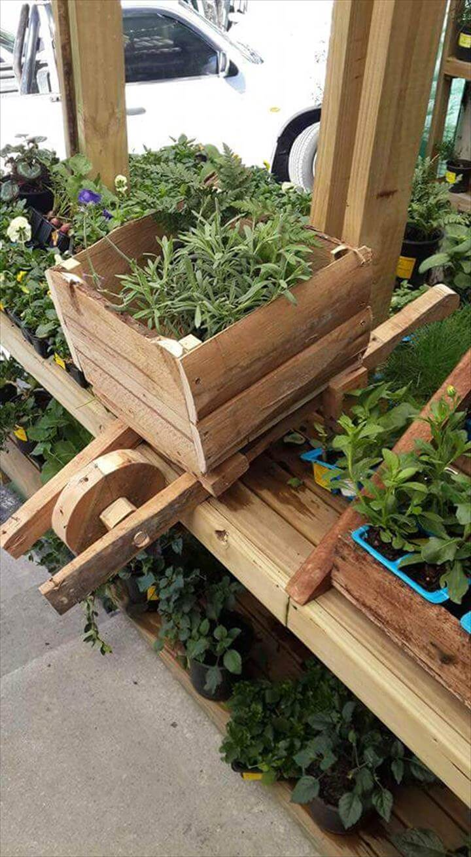 reclaimed pallet wheelbarrow planter